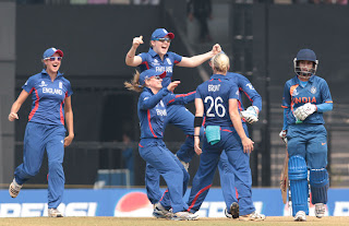 Katherine-Brunt-celebrates-with-her-teammates-after-taking-the-wicket-of-Mithali-Raj