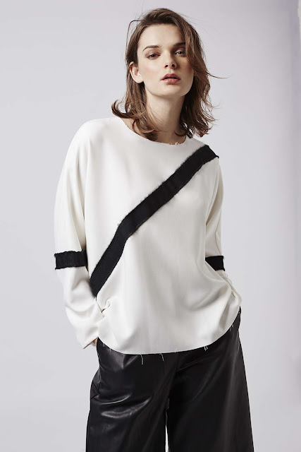 white jumper black diagonal stripe