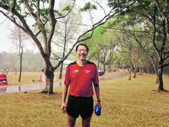NICE TO GET WET: Deputy PM Teo basking in the rain yesterday after a community run in Pasir Ris Park. His Facebook post had garnered more than 730 likes as of 10pm yesterday.