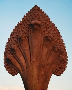Ananta-Sesha, the serpent with many heads who supports the earth; Deccan stone carving