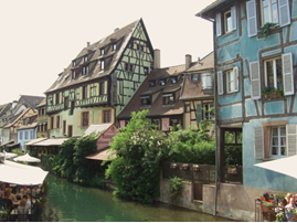 Colmar canal, colourful beamed Alsatian buildings. Photo taken from a bridge