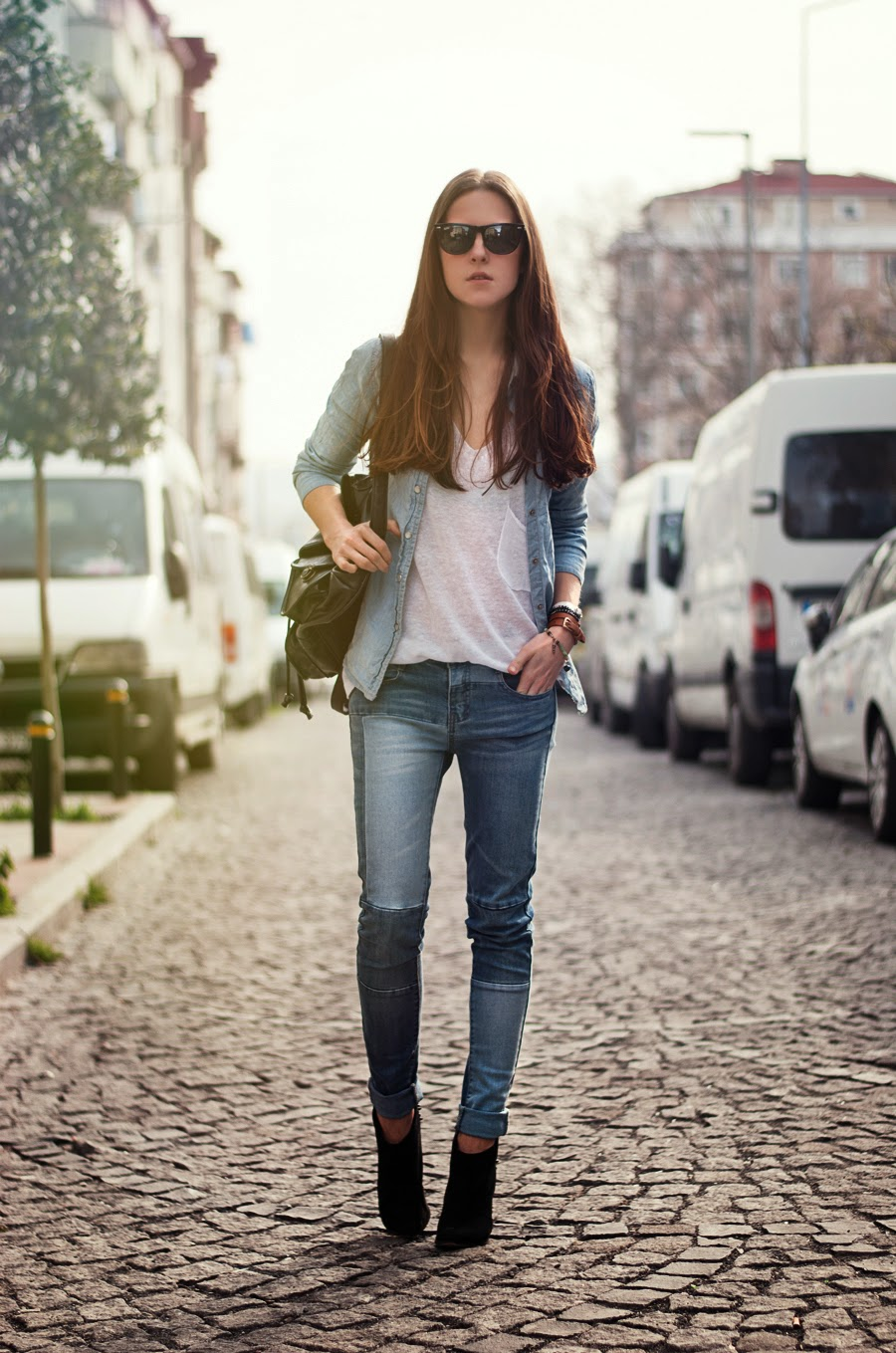 street style istanbul, russian fashion blogger, denim on denim outfit , ray ban outfit, patched jeans outfit , long hair , spring 2014 streetstyle women