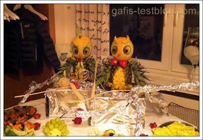 Tischdeko Eulen aus Ananas und Melonen