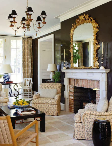 large black walls living room gold accents beige neutral furniture