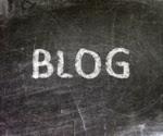 """The word """"BLOG"""" written in white chalk on a gray slate blackboard"""