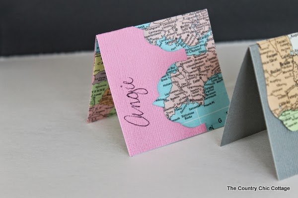 http://www.thecountrychiccottage.net/2014/02/recycled-map-placecards.html