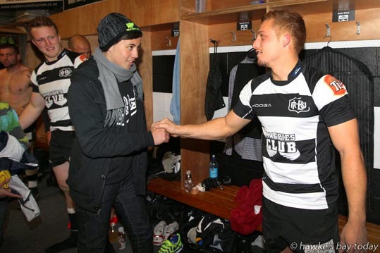 L-R: Azaleas Quenton, 12, Hastings, an assault victim; Ihaia West - Azaleas Quenton got to meet the Magpies and was presented with a jersey after the game - Hawke's Bay Magpies vs Taranaki - Rugby at McLean Park, Napier. Magpies won 29-26 photograph