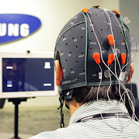 scientist demonstrating thought control wearing a cap with eeg electrdes