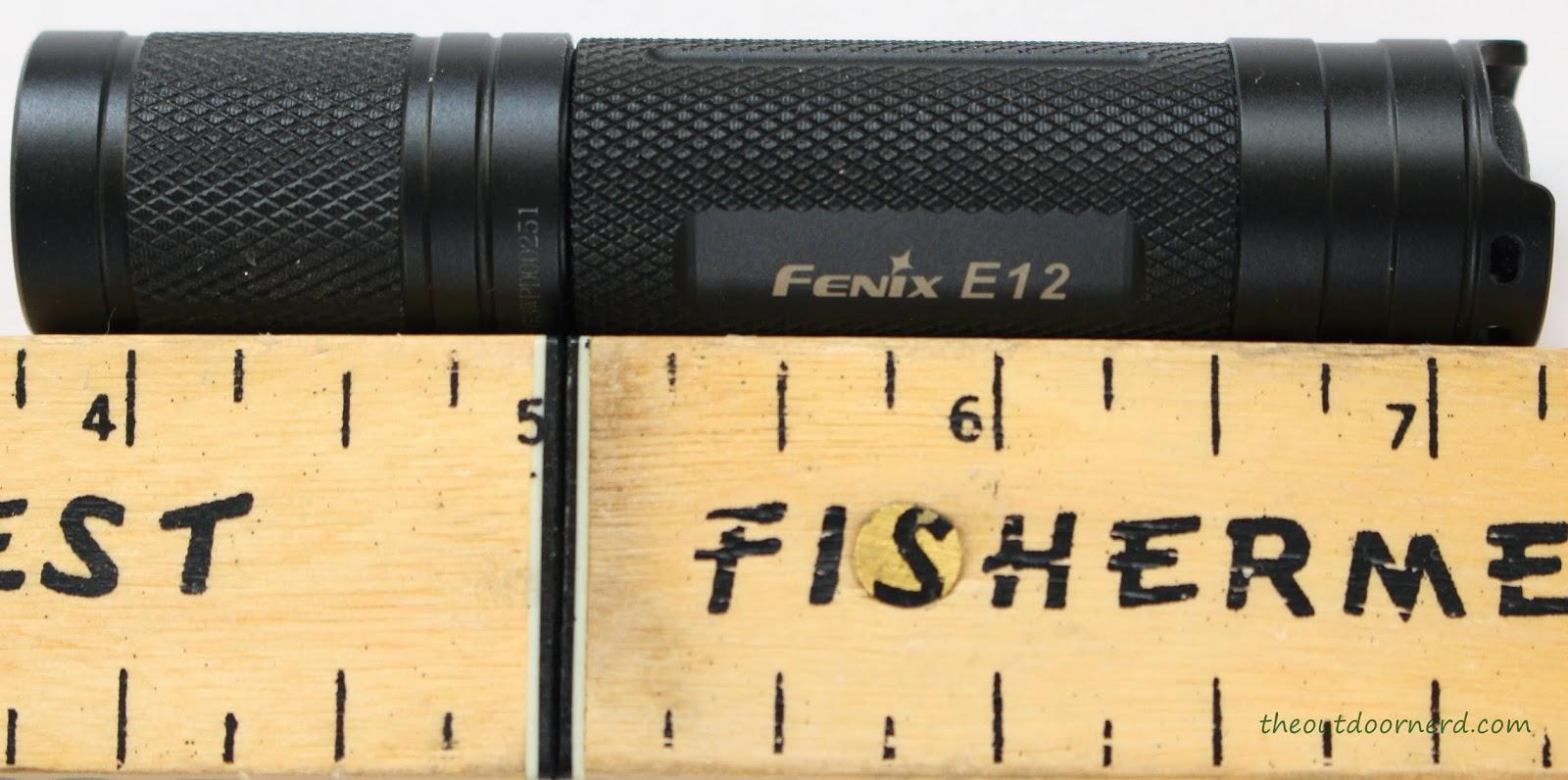 Fenix E12 1xAA EDC Flashlight Next To Ruler