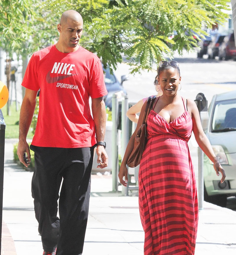 black actress Nia Long pregnant walking with her husband