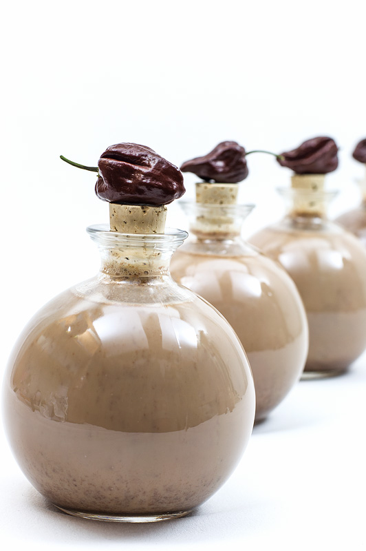 Chocolate liquor with chili in bomb bottle with chili on top