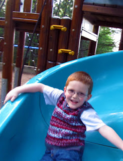 Little Mister going down a slide