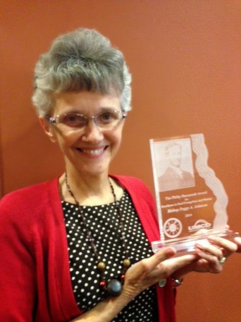 Bishop Peggy Johnson with award