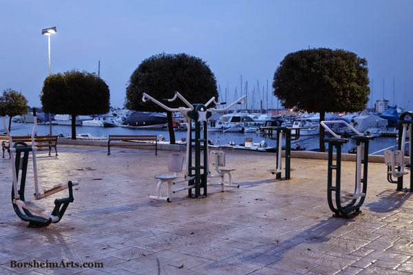 outdoor gym with view of harbor harbour Umag Croatia