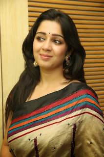 Actress Charmi Kaur Pictures in Saree at Jyothi Lakshmi First Look Launch  11