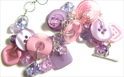 Bracelet has pink and purple buttons with crackle beads in pretty charm style design