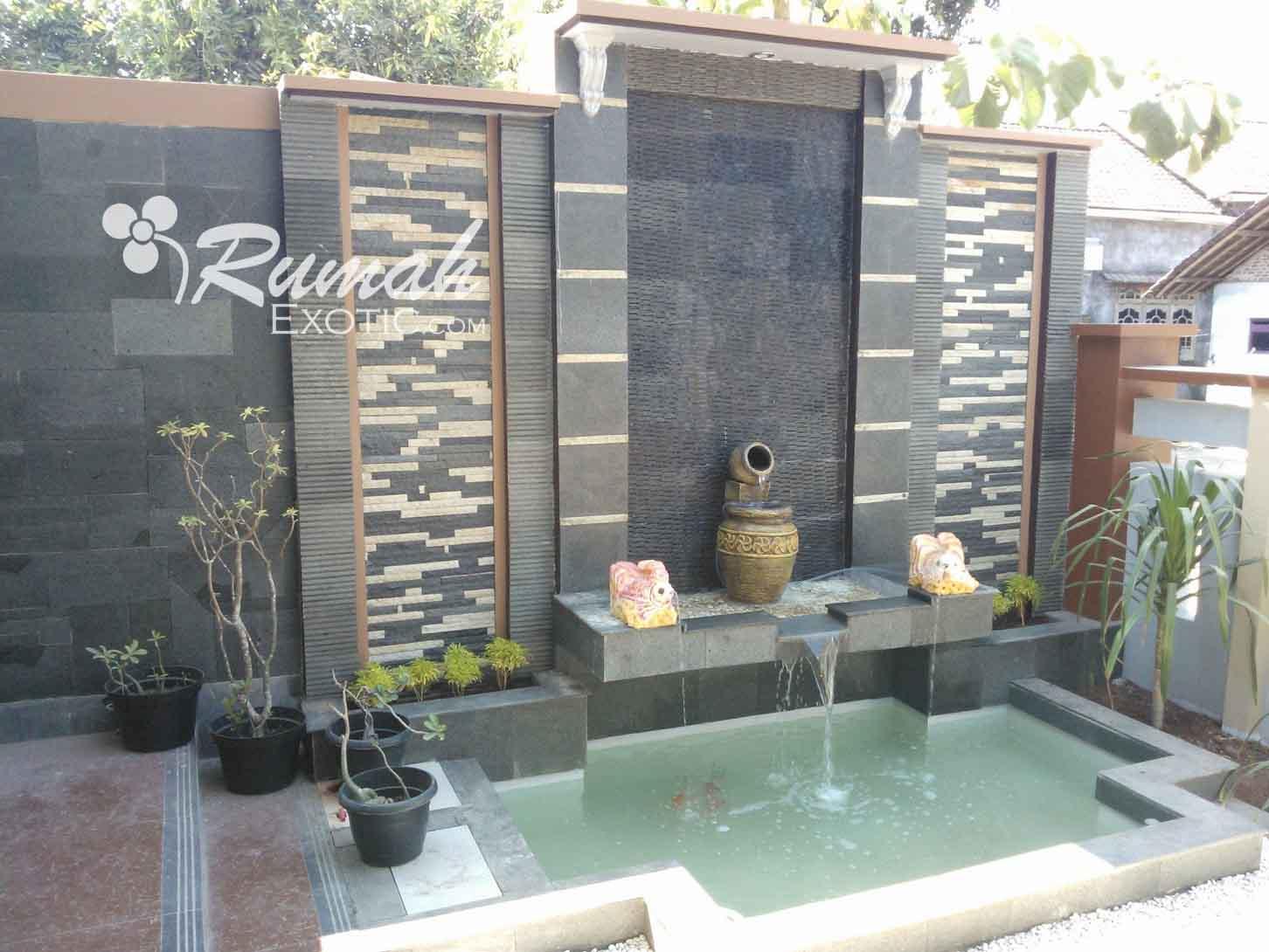 desain kolam ikan dan taman minimalis dengan batu alam