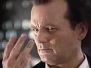 Bill Murray holding up three fingers as Frank Cross in Scrooged 1988 movieloversreviews.blogspot.com