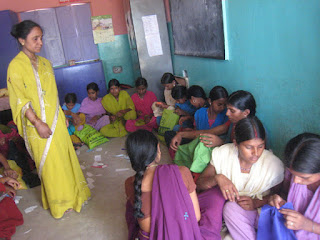The Sewing Center is located at the Shekhwara Village School. This picture shows several women at the center.