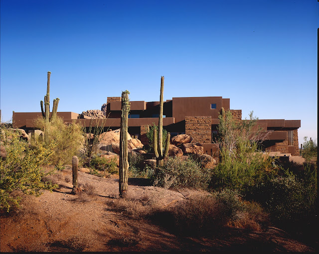 Picture of the house with cactuses
