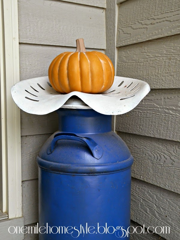 Pumpkin on a milk can seat - fall decor