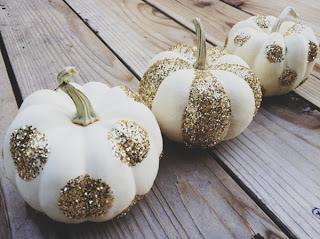 white mini pumpkin with gold glitter