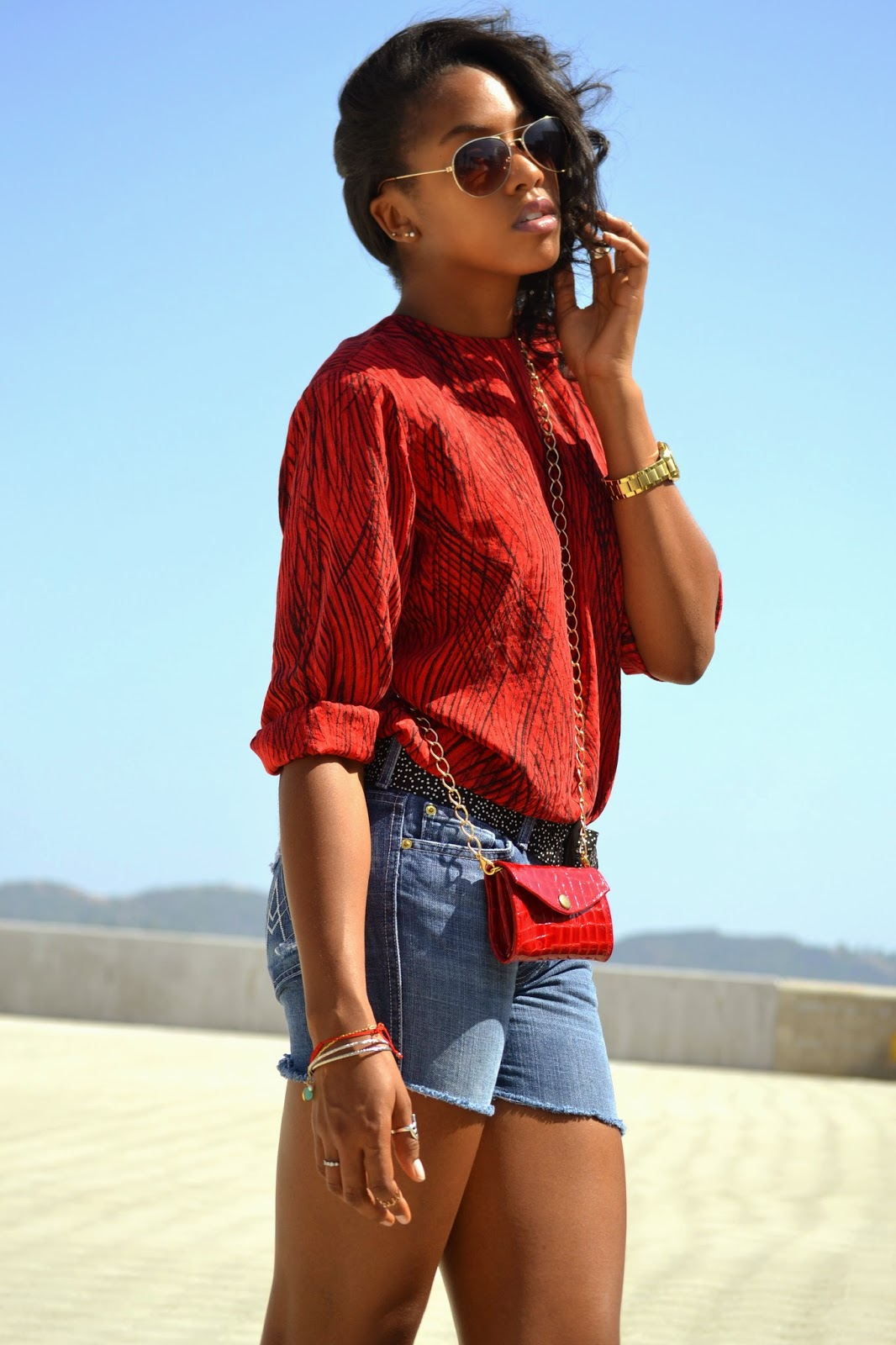 Wearing Red vintage top 7 For All Mankind denim cutoffs Vintage Dotted belt Gabbag crossbody bag