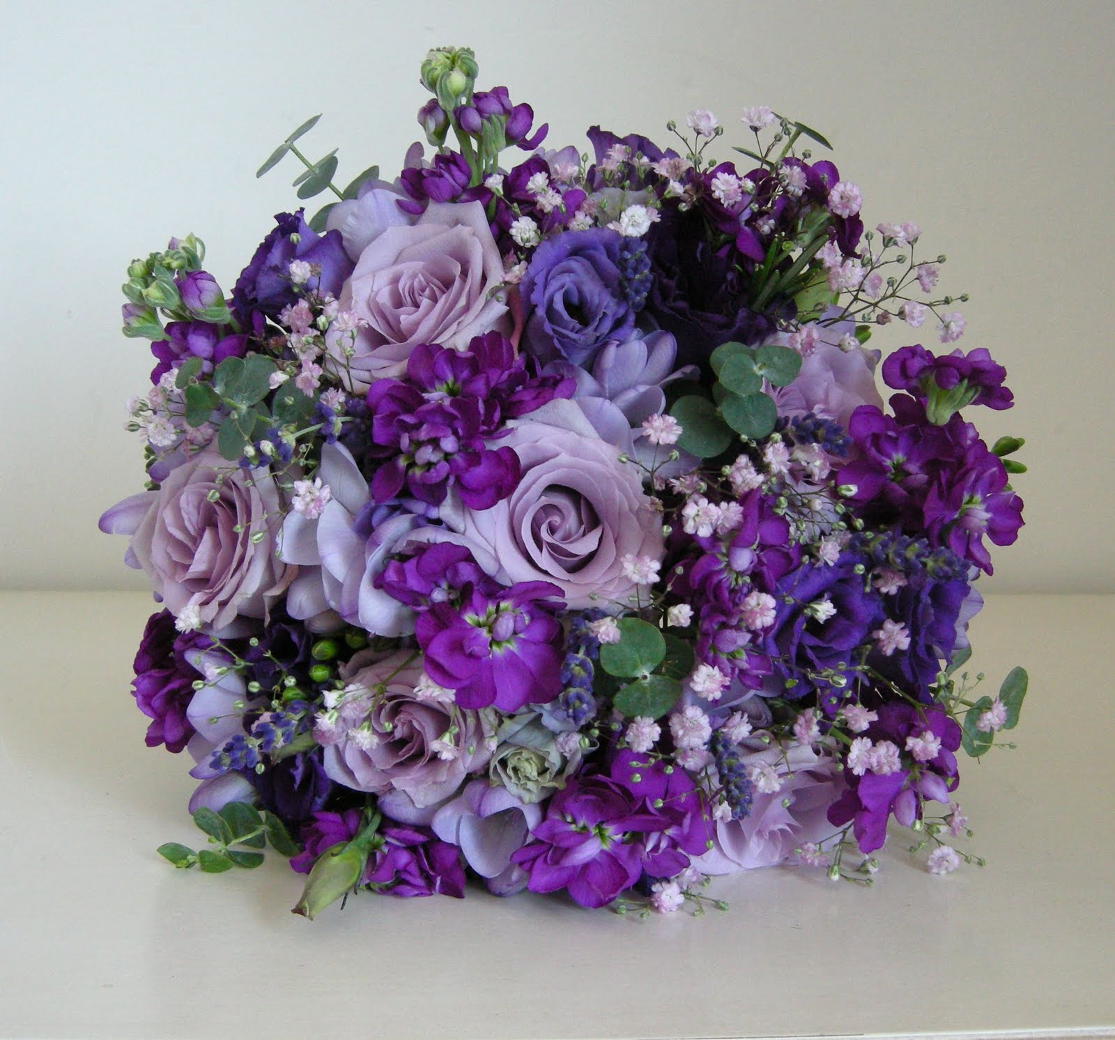 Groom's buttonhole of lilac rose, lavender and rosemary with a tiny ...
