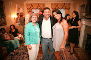 Holly Petraeus (left) with Scott Kelley (center) and Jill Kelley (right) at .