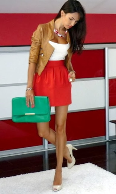 Red mini skirt, white top and brown leather jacket