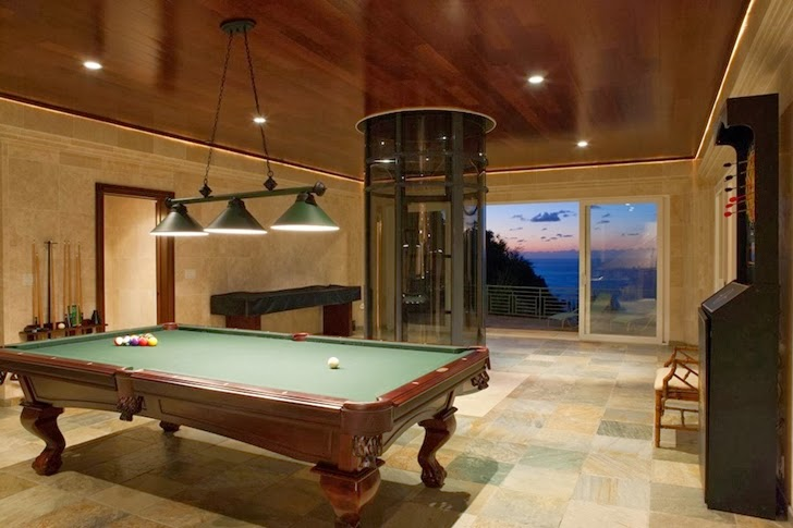 Entertainment room in an Impressive Waterfall House in Hawaii