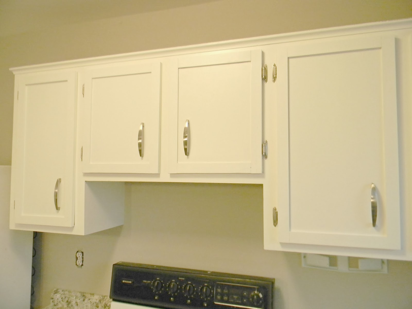 silver hinges instead of old dingy rusty ones finish off the cabinets