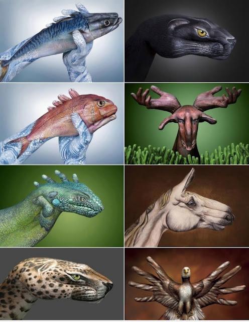 Mãos humanas pintadas de animais