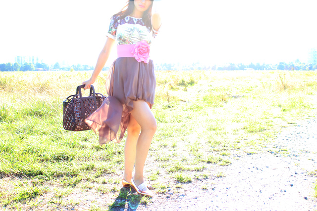 vancouver fashion blogger jasmine zhu wearing a printed dress over a sheer maxi skirt, clover canyon printed dress, large flower belt, vanlaced avenue purse, street style, creative styling