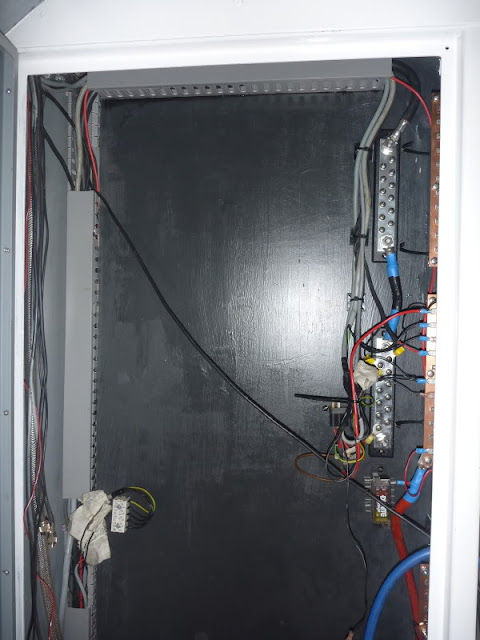 The empty electrical cupboard. With Blue Sea Systems bus bars for the negatives, and Victron ESP panels for DC positive overcurrent protection