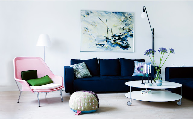 living room blue velvet sofa pink side chair oval white coffee table modern home decor design