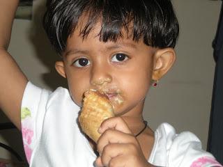 baby girl photograph eating icecream