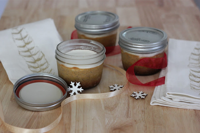 pumpkin pie in mason jars with sour cream topping