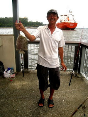Scat or Kim Kor 金鼓, 金錢魚 weighing about 1kg Caught by Ah Yap At Woodland Jetty