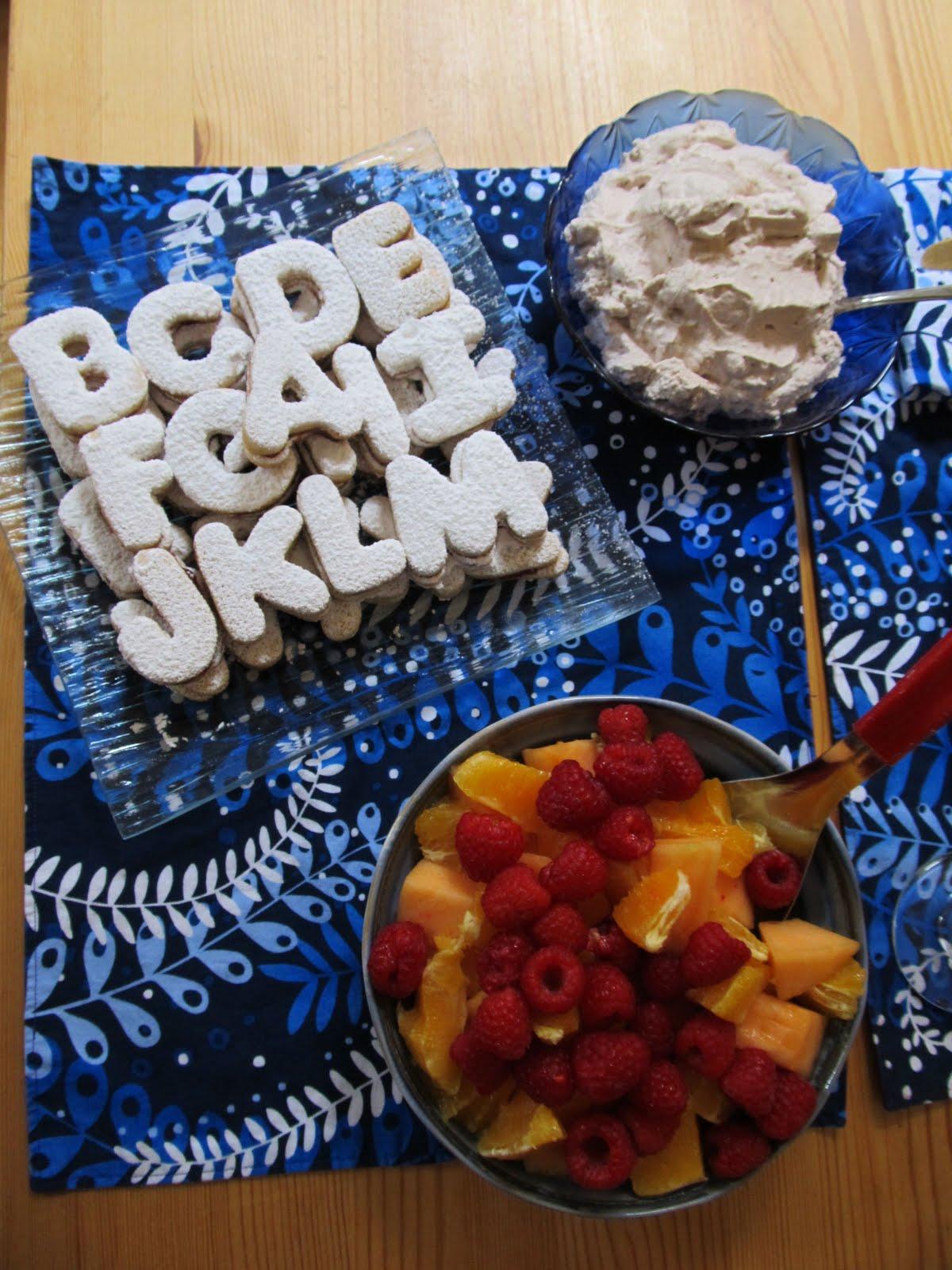 Sandwich sugar-cookies with raspberry jam.