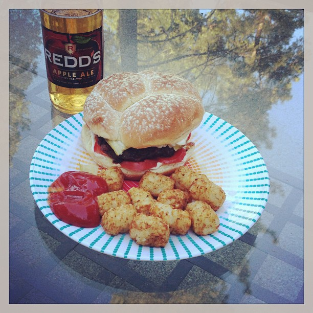hamburger, tots, redd's apple ale