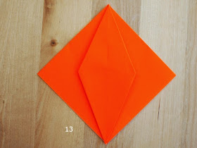 step 13 showing how to fold an origami pumpkin