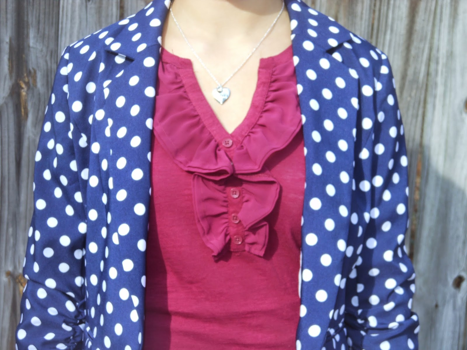 Polka Dots and Plum. Polka dot blazer, plum purple ruffle top, jeans, brown riding boots, simple jewelry.