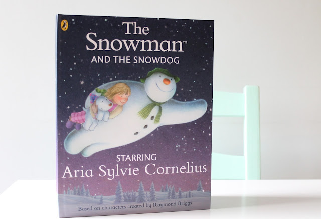 Personalised The Snowman and the Snowdog book starring Aria Sylvie Cornelius