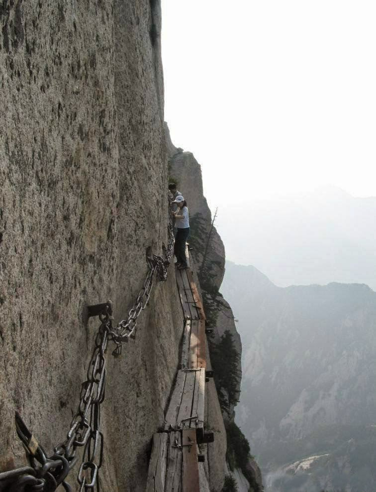 chains and carabiners are the railings which you can grasp while traversing the plank path