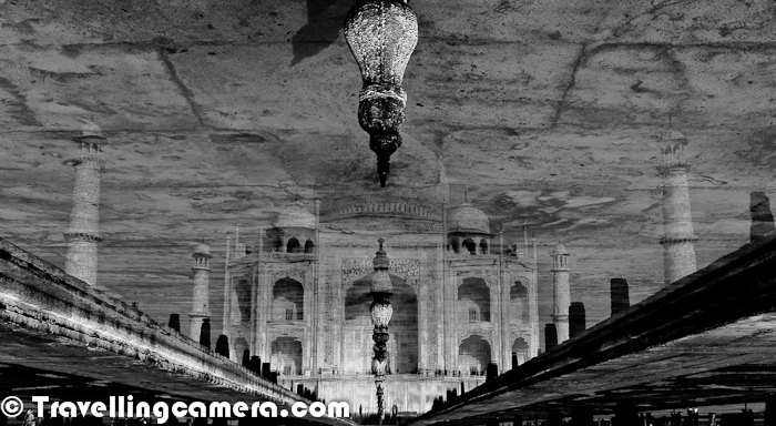 TAJ is wonderful example of Mughal Architecture and considered as one of the finest creation by Mughals. This Photo Journey shares some of the old photographs of Taj Mahal in different shades of Blacks & Whites.First photograph of this Photo Journey shows main entry through which we get to see Taj Mahal. This place gives a wonderful view of Taj and especially moment is very precious for folks coming first time to see Taj Mahal in reality. There is huge difference between the Taj we see in photographs and Videos. It's amazing to see it in realityWeather of Agra is not very good, but still it gets lot of tourists in every month. It's too hot during summers and foggy in winters. I never visited Agra in Monsoon, so no comments about that :) ... but of-course, monsoons are generally not good to visiting places like Agra. Agra is one of the popular weekend destination for people in Delhi and mostly people prefer to come during winters.After crossing the main gate, we enter into a huge compound with various gardens around main building of Taj Mahal. There is a water stream in the middle which flows towards entry gate. Reflection photographs of Taj Mahal in this water stream is one of the popular shots, which is tried by almost every visitor of Taj Mahal. In above photograph just notice the alignment of two towers around main dome.  Both of them are not straight and leaning outwards. This was something intentional. The marble dome that surmounts the tomb is the most spectacular feature. Its height of around 35 meters is about the same as the length of the base and is accentuated as it sits on a cylindrical