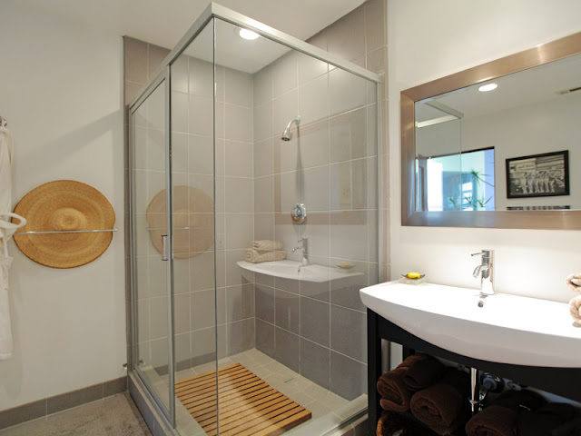 Photo of modern bathroom interiors showing shower cabin and the sink