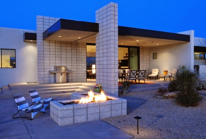 Elegant home with fire pit in the garden