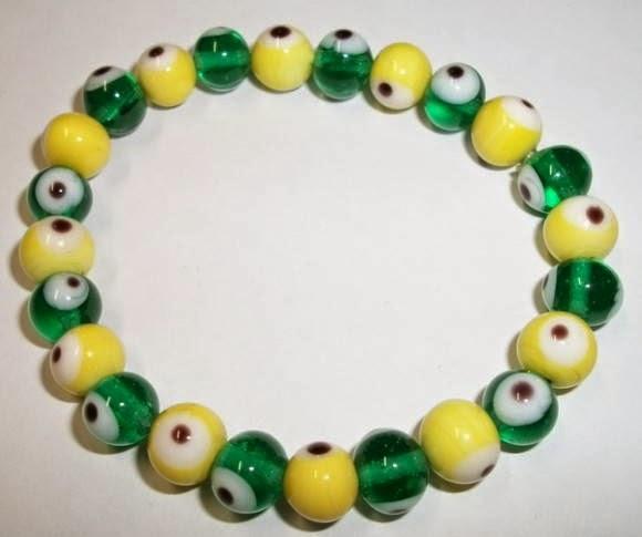 http://www.elo7.com.br/pulseira-olho-grego-verde-e-amarela/dp/B6071