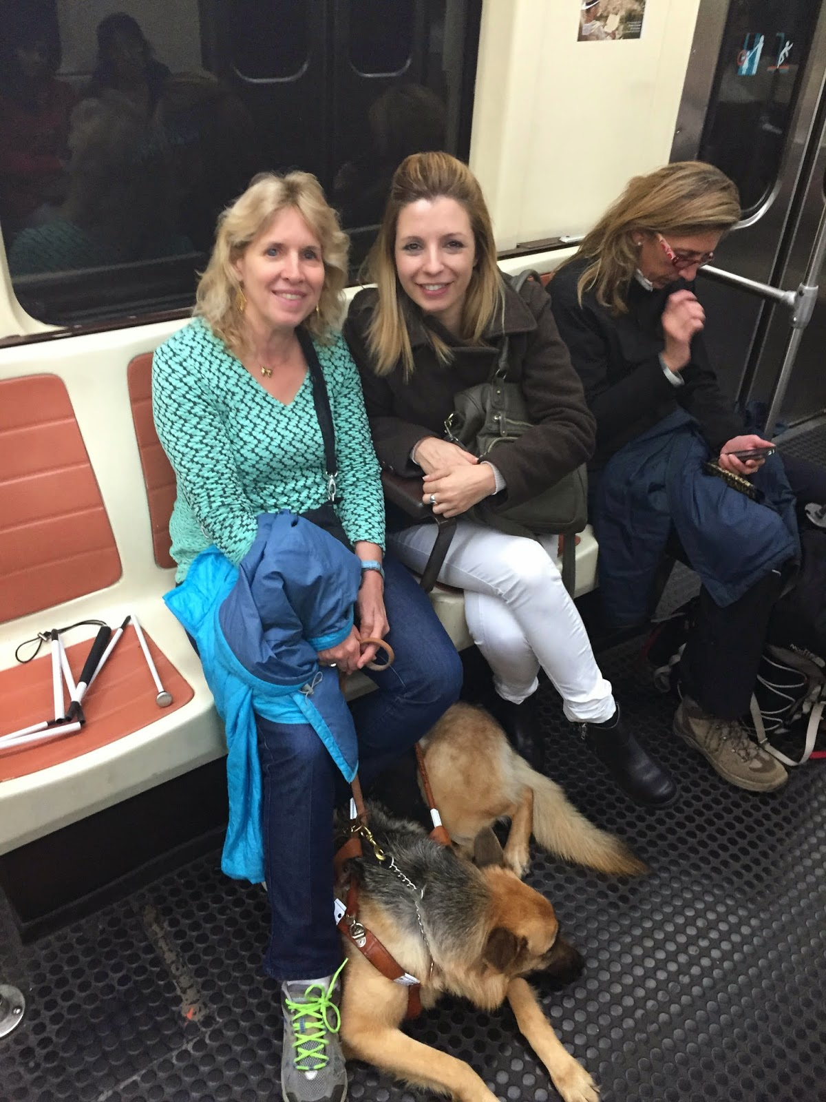 Gena and Alejandra on the subway in Madrid